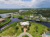 T.J. Thornberry built custom home on 150' of concrete seawall - only one bridge out - Single Family Home for sale at 17296 Foremost Ln, Port Charlotte, FL 33948 - MLS Number is C7240998