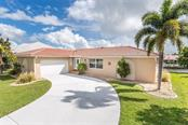 Waterfront canal home with oversized pool, split floor plan and fully furnished/turn-key - Single Family Home for sale at 890 Coronado Dr, Punta Gorda, FL 33950 - MLS Number is C7243197