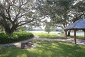 Part of the walking path that surrounds the lake - bring your lunch and enjoy the lovely view! - Villa for sale at 1234 Green Oak Trl, Port Charlotte, FL 33948 - MLS Number is C7243720