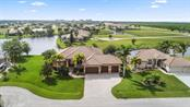 Southern facing custom lakefront pool home situated on an oversized parcel in the deed restricted community of Burnt Store Lakes. - Single Family Home for sale at 17208 Barcrest Ln, Punta Gorda, FL 33955 - MLS Number is C7245458