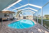 Inviting waters. Ready for a swim? - Single Family Home for sale at 2510 Rio Largo Ct, Punta Gorda, FL 33950 - MLS Number is C7246934