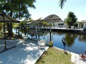 Single Family Home for sale at 3207 Sunny Harbor Dr, Punta Gorda, FL 33982 - MLS Number is C7250671
