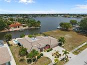 Home sits on 100' of cement seawall with amazing views - Single Family Home for sale at 158 Morgan Ln Se, Port Charlotte, FL 33952 - MLS Number is C7400633