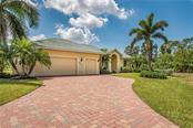 Your long paver drive gives you plenty of room for guests. - Single Family Home for sale at 931 Linkside Way, Punta Gorda, FL 33955 - MLS Number is C7400849