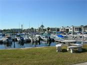 Saltwater marina with free boat slips - Manufactured Home for sale at 11 Holland Ave, Punta Gorda, FL 33950 - MLS Number is C7401035