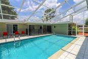 pool with view of main house #1 - Single Family Home for sale at 3262 Great Neck St, Port Charlotte, FL 33952 - MLS Number is C7403390