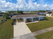 Birds eye view with canal & Edgewater Lake beyond - Single Family Home for sale at 126 Bangsberg Rd Se, Port Charlotte, FL 33952 - MLS Number is C7409866