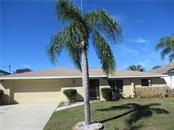 Single Family Home for sale at 1481 Achilles St, Port Charlotte, FL 33980 - MLS Number is C7411507