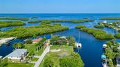 The nicest and best priced lot in Pirate Harbor for location - in minutes and you are out to Charlotte Harbor!  Build your dream home and enjoy a magnificent view - Vacant Land for sale at 24166 Henry Morgan Blvd, Punta Gorda, FL 33955 - MLS Number is C7417999