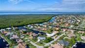 Imagine living here with fast sailboat access out to Charlotte Harbor - Single Family Home for sale at 5001 Captiva Ct, Punta Gorda, FL 33950 - MLS Number is C7422558