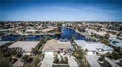 Enjoy the long intersecting canal view and a short ride to Charlotte Harbor, Boca Grande and the Gulf. Boating from 80' of waterfront at its finest! - Single Family Home for sale at 1440 Appian Dr, Punta Gorda, FL 33950 - MLS Number is C7425399