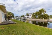 Updated and welcoming home in the heart of Pirate Harbor! - Single Family Home for sale at 24368 Blackbeard Blvd, Punta Gorda, FL 33955 - MLS Number is C7436898