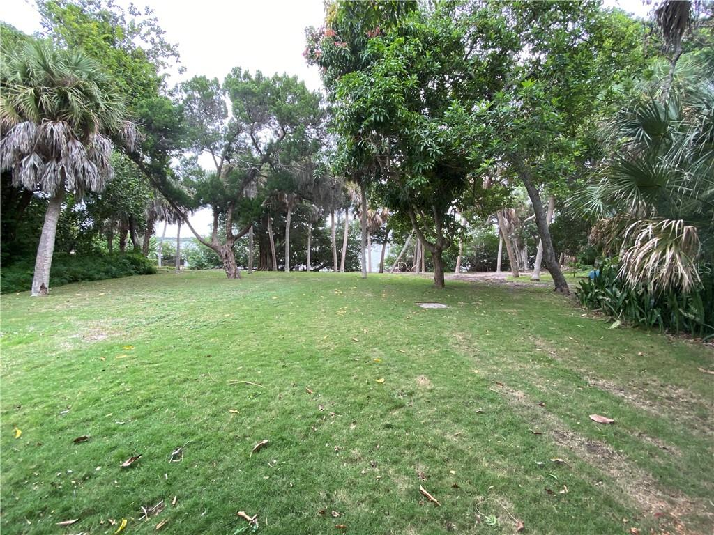 The generous lot is 450' deep and slopes gently to Little Sarasota Bay. - Vacant Land for sale at 608 N Casey Key Rd, Osprey, FL 34229 - MLS Number is A4127758