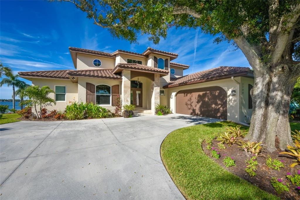 Single Family Home for sale at 7794 Holiday Dr N, Sarasota, FL 34231 - MLS Number is A4156411