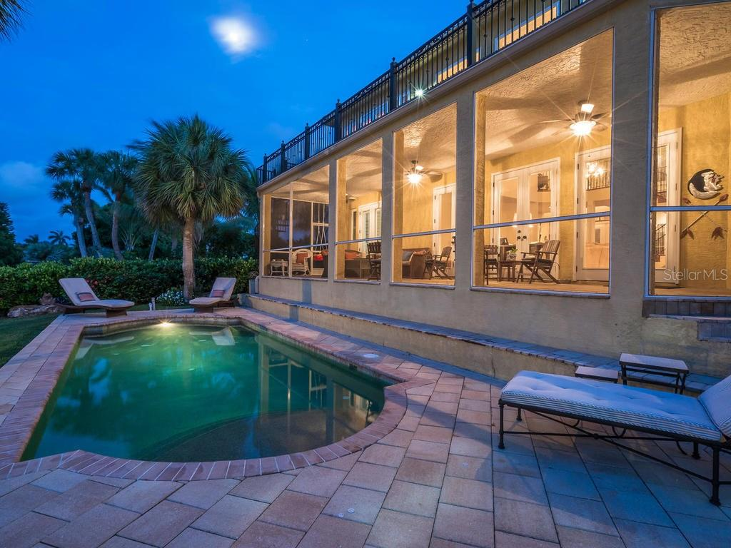 Swimming pool with paver patio - Single Family Home for sale at 5555 Cape Leyte Dr, Sarasota, FL 34242 - MLS Number is A4157475