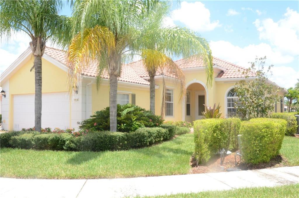 Front of home showcasing beautiful landscape and well cared for property. - Single Family Home for sale at 13328 Coluccio St, Venice, FL 34293 - MLS Number is A4160649