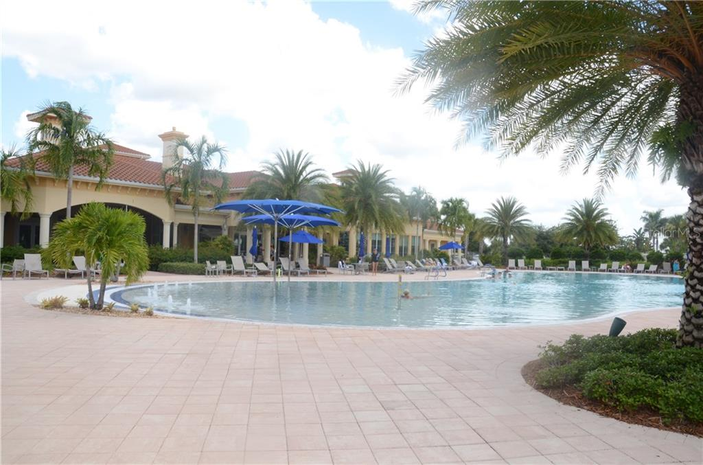 Fantastic pool area with an abundance of lounging chairs. This area also has one outdoor grill available for resident's use (there are others available by the second community building) - Single Family Home for sale at 13328 Coluccio St, Venice, FL 34293 - MLS Number is A4160649