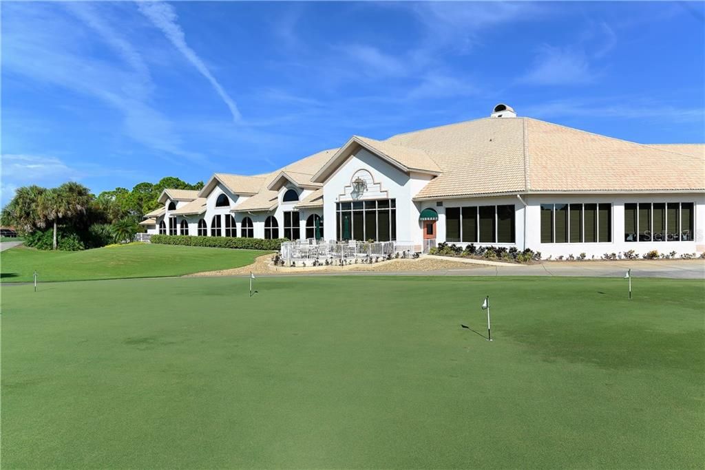 Stoneybrook Golf & Country Club multi-faceted, multi-windowed club house overlooks the club's practice area and signature 18th hole green. - Single Family Home for sale at 8753 Merion Ave, Sarasota, FL 34238 - MLS Number is A4165409