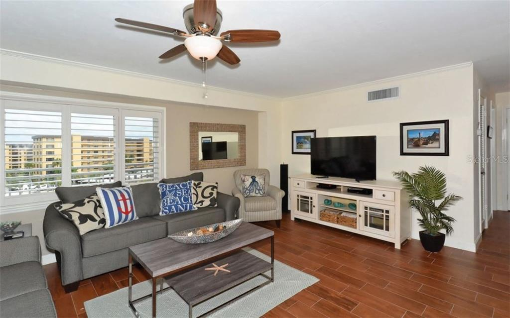 Living room - Condo for sale at 5830 Midnight Pass Rd #504, Sarasota, FL 34242 - MLS Number is A4166623