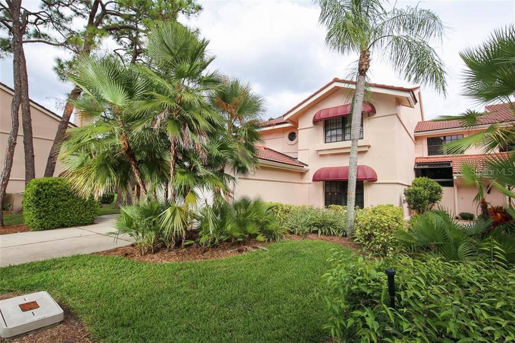 Front exterior - Condo for sale at 7631 Fairway Woods Dr #601, Sarasota, FL 34238 - MLS Number is A4168292