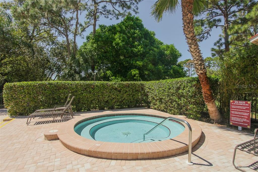 Community spa - Condo for sale at 7631 Fairway Woods Dr #601, Sarasota, FL 34238 - MLS Number is A4168292