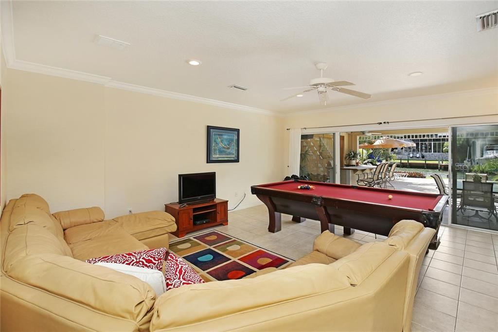 Indoor Entertaining Space or Bonus Room leading from Elevator Landing and Entrance to Spacious 3-Car Garage. - Single Family Home for sale at 722 Siesta Dr, Sarasota, FL 34242 - MLS Number is A4169257