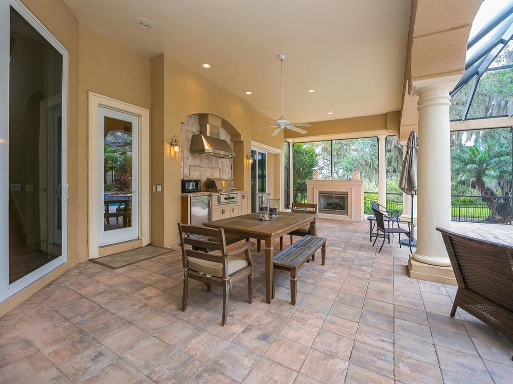 Outdoor living is a must.  Enjoy the fountains splashing into the pool, quiet areas of the golf course, a kitchen/grill area and a gas fireplace for chilly evenings. - Single Family Home for sale at 3313 Founders Club Dr, Sarasota, FL 34240 - MLS Number is A4169443