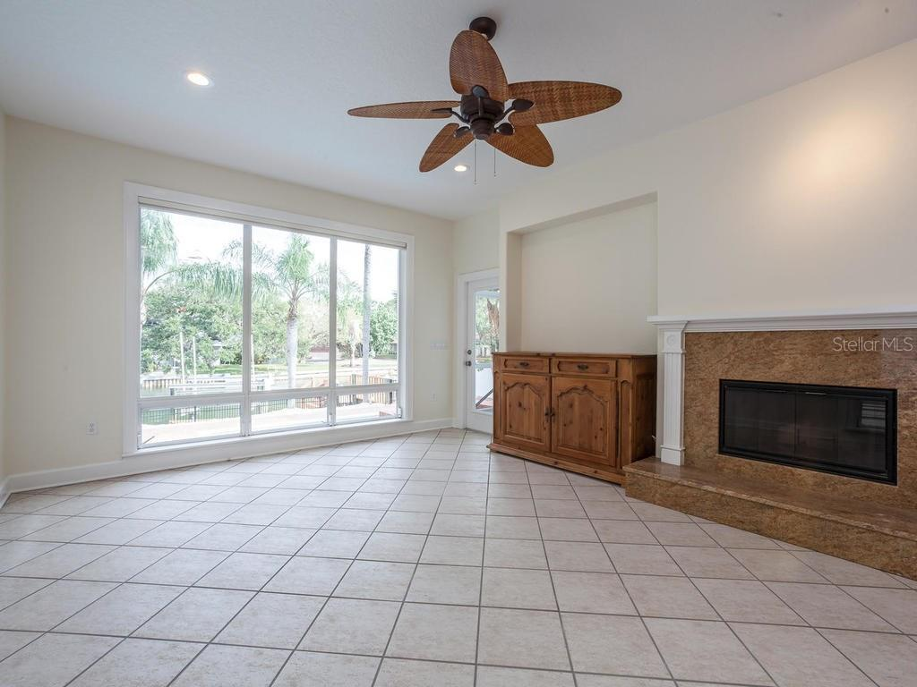 Family room with fireplace - Single Family Home for sale at 4789 Higel Ave, Sarasota, FL 34242 - MLS Number is A4169949