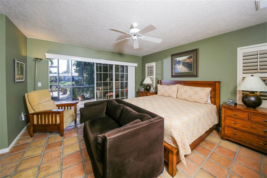 Master bedroom with pocketing sliding doors with direct water views. - Single Family Home for sale at 5281 Cape Leyte Way, Sarasota, FL 34242 - MLS Number is A4171478