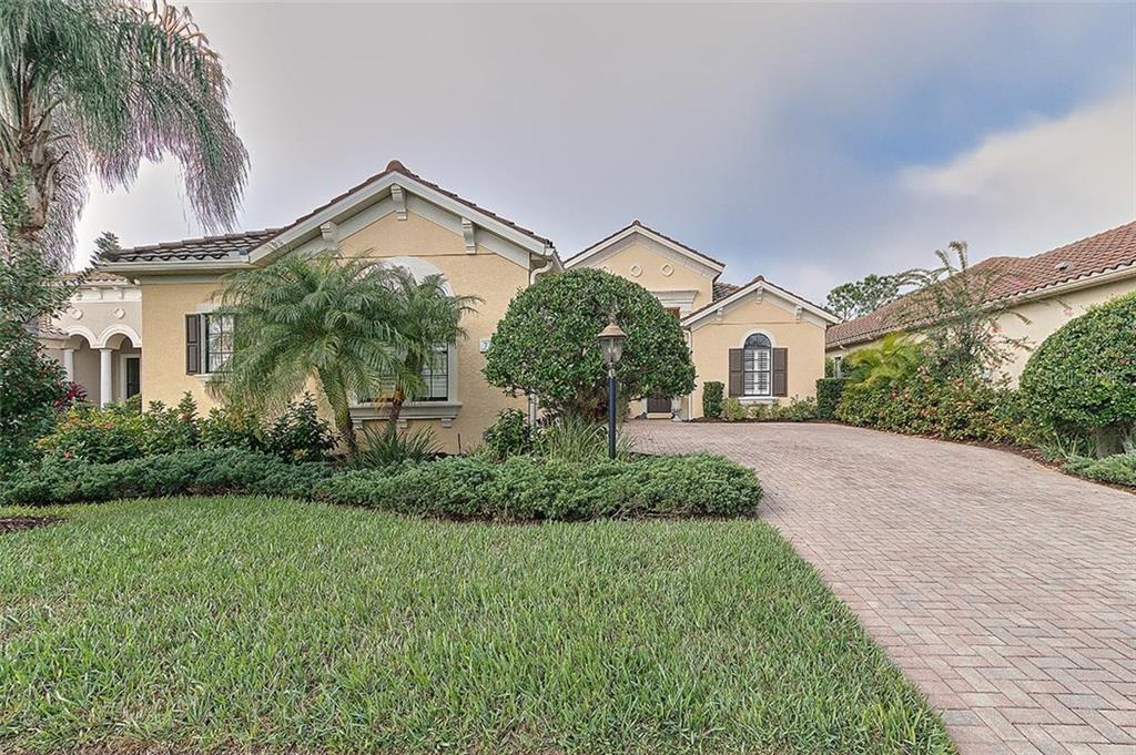 Maintenance Free Community - Single Family Home for sale at 7254 Lake Forest Gln, Lakewood Ranch, FL 34202 - MLS Number is A4174107