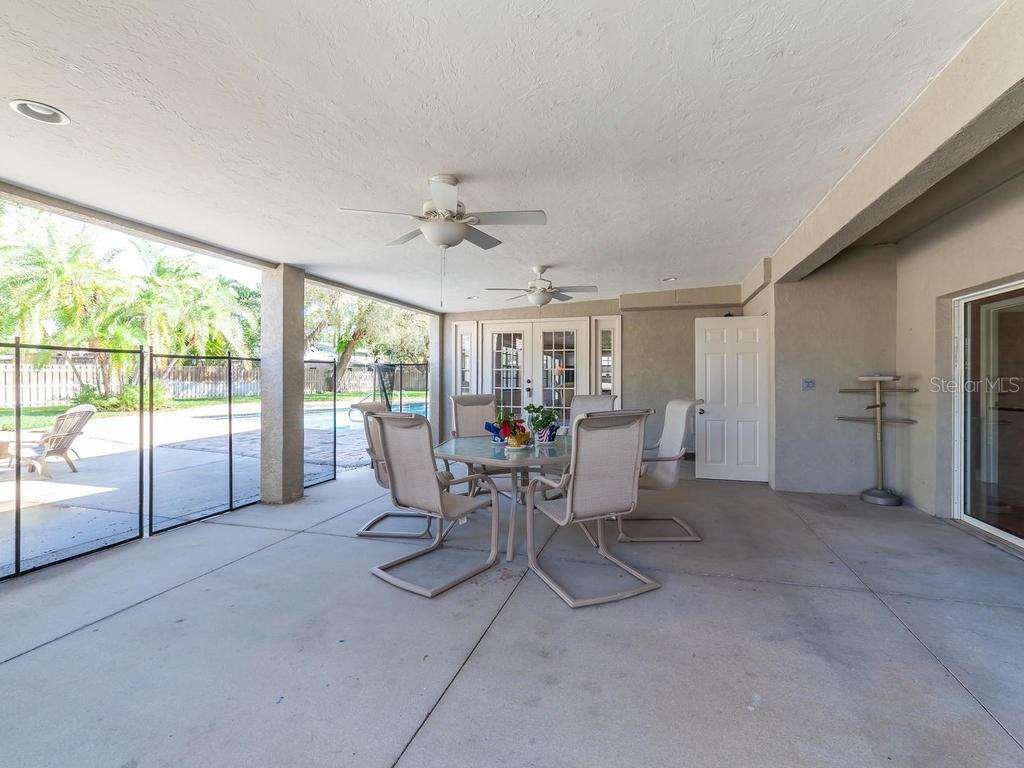 Covered exterior patio with child protective pool fence - Single Family Home for sale at 7812 17th Ave W, Bradenton, FL 34209 - MLS Number is A4178350