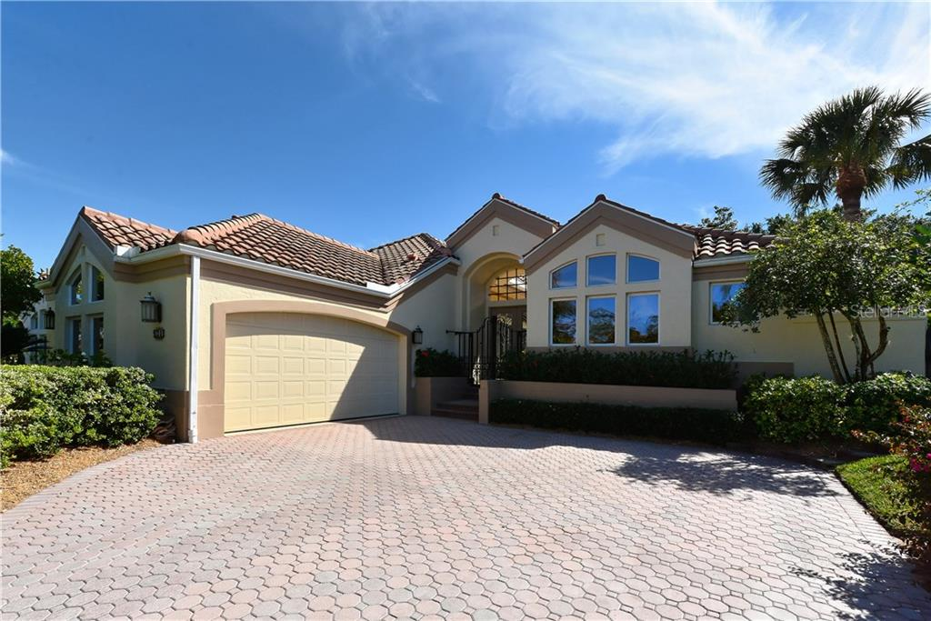 Front of home - Single Family Home for sale at 602 Weston Pointe Ct, Longboat Key, FL 34228 - MLS Number is A4178531