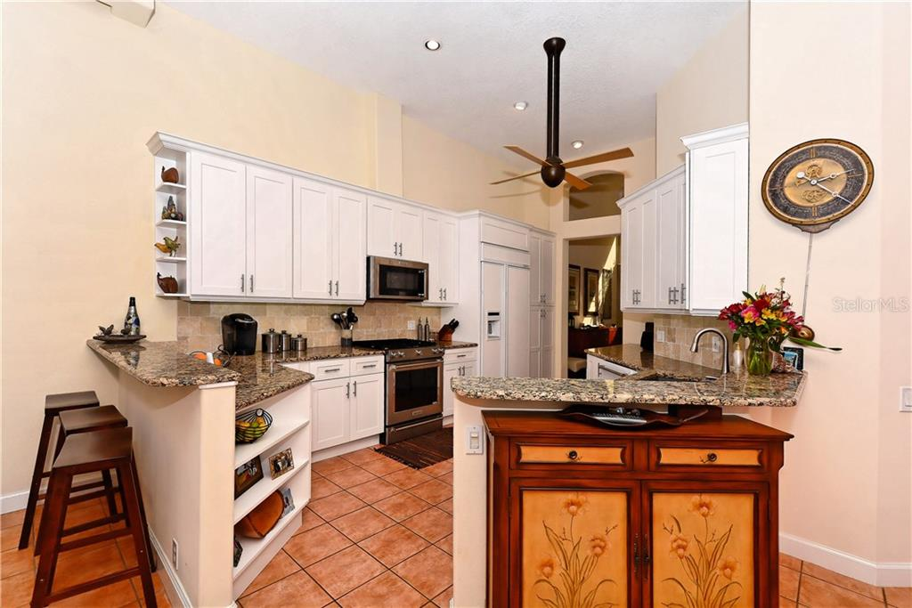Breakfast bar and Kitchen looking from Dinette - Single Family Home for sale at 602 Weston Pointe Ct, Longboat Key, FL 34228 - MLS Number is A4178531