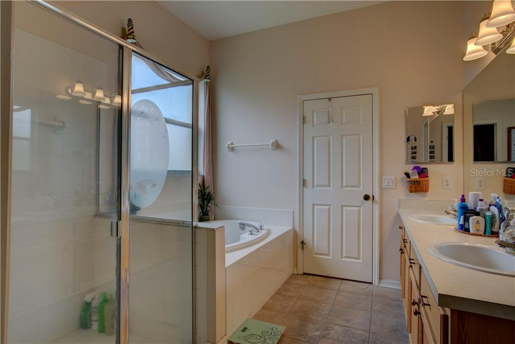 Master bath with large walk in closet to the back - Single Family Home for sale at 4516 Useppa Dr, Bradenton, FL 34203 - MLS Number is A4178602