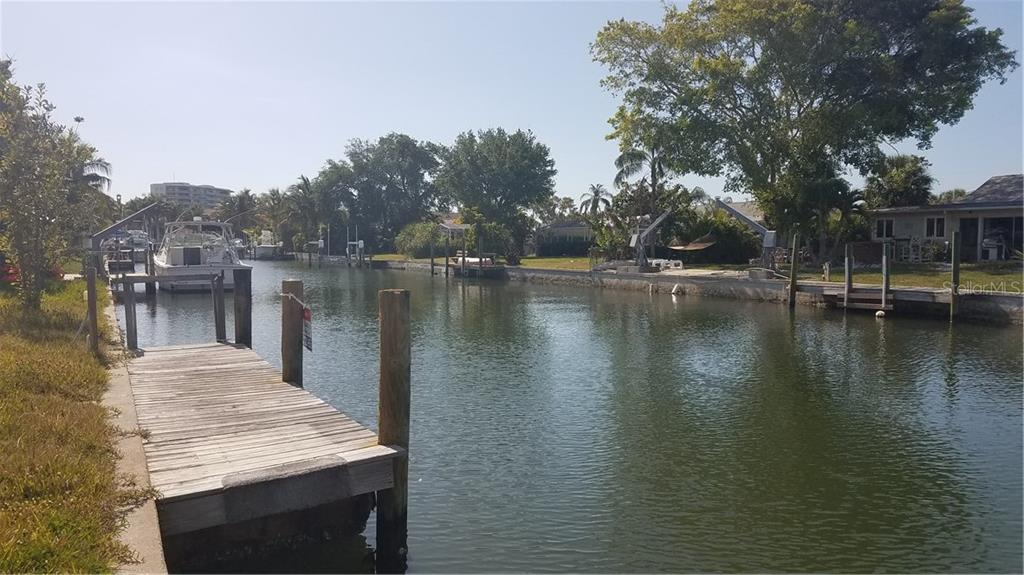 West along canal showing dock - Vacant Land for sale at 1609 Ridgewood Ln, Sarasota, FL 34231 - MLS Number is A4181542