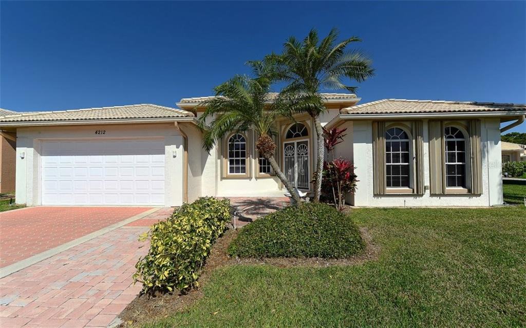 Front exterior - Single Family Home for sale at 4212 Hearthstone Dr, Sarasota, FL 34238 - MLS Number is A4181883
