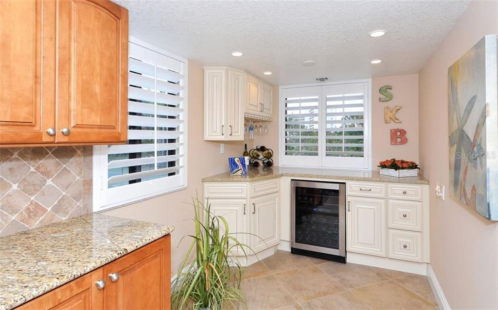 Kitchen with built-in wine cooler - Condo for sale at 6263 Midnight Pass Rd #101, Sarasota, FL 34242 - MLS Number is A4182245