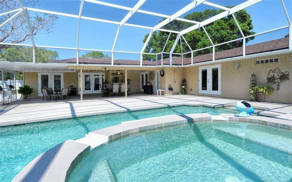 Oversized inviting pool, 42 X 36 screened porch, outdoor shower. Great for entertaining!! - Single Family Home for sale at 6239 Hollywood Blvd, Sarasota, FL 34231 - MLS Number is A4182790