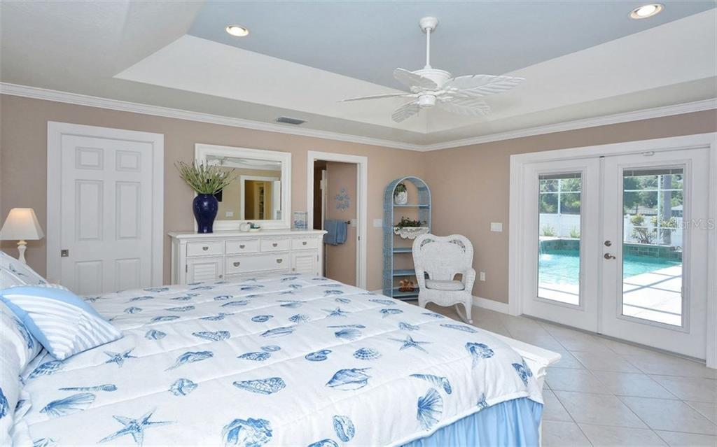 Master bedroom has tile floors, French doors to the pool and lanai. - Single Family Home for sale at 6239 Hollywood Blvd, Sarasota, FL 34231 - MLS Number is A4182790
