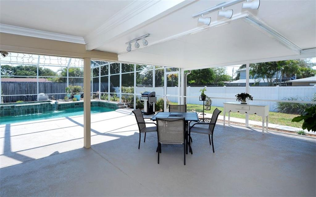 Great side yard for play and privacy. - Single Family Home for sale at 6239 Hollywood Blvd, Sarasota, FL 34231 - MLS Number is A4182790