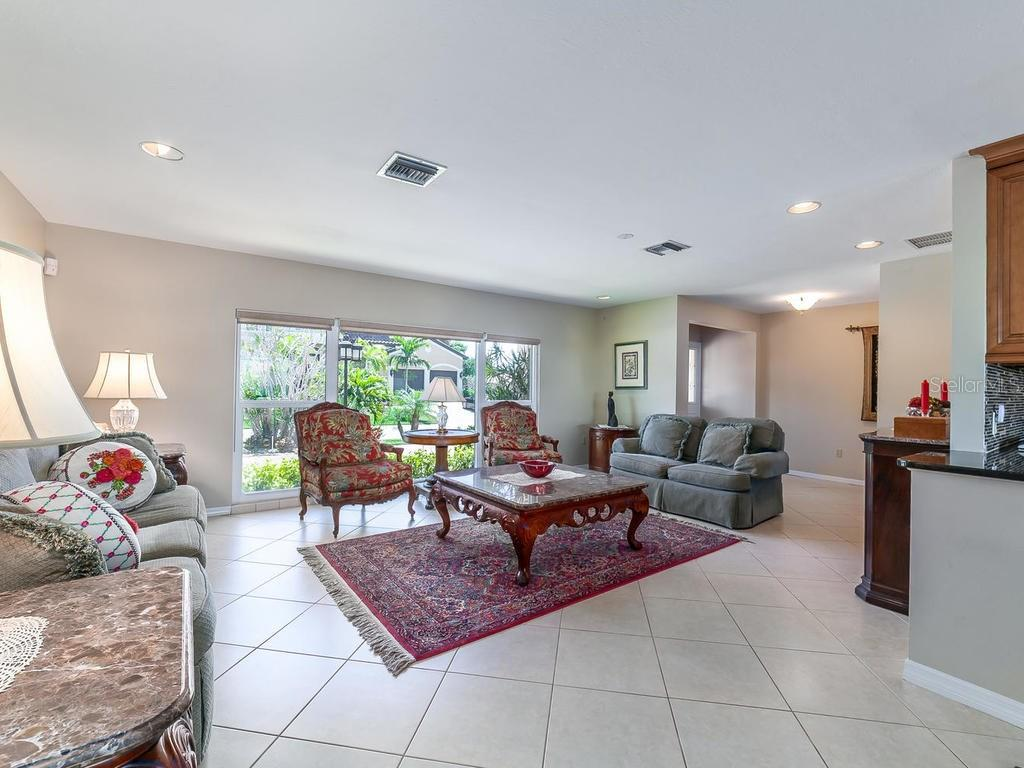 Living room/Dining room - Single Family Home for sale at 551 Putting Green Ln, Longboat Key, FL 34228 - MLS Number is A4183977
