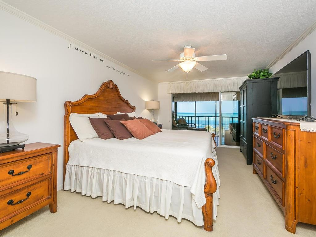 Master bedroom with sliders to balcony - Condo for sale at 4708 Ocean Blvd #e8, Sarasota, FL 34242 - MLS Number is A4184028