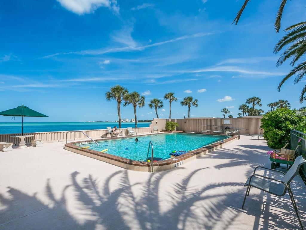 Community swimming pool and sun deck - Condo for sale at 4708 Ocean Blvd #e8, Sarasota, FL 34242 - MLS Number is A4184028