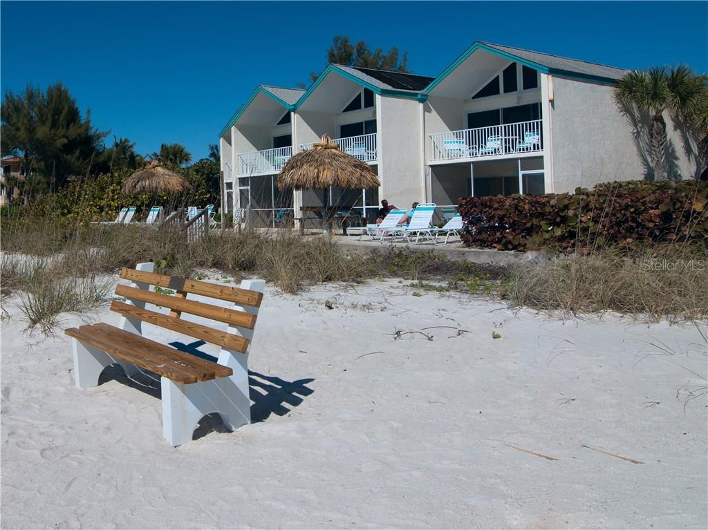 Coconuts from the beach.  Unit is upper, third from right side. - Condo for sale at 100 73rd St #202a, Holmes Beach, FL 34217 - MLS Number is A4184505