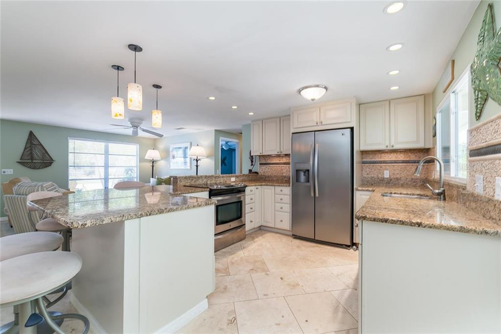 Soft close cabinetry and stainless appliances in the kitchen...the refrigerator is full size, not counter depth! - Single Family Home for sale at 413 Bay Palms Dr, Holmes Beach, FL 34217 - MLS Number is A4184679