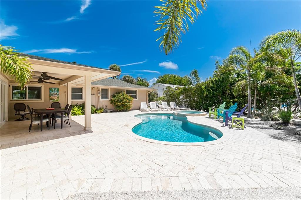 Beautiful pavers create a great space for entertanining family and friends. - Single Family Home for sale at 413 Bay Palms Dr, Holmes Beach, FL 34217 - MLS Number is A4184679