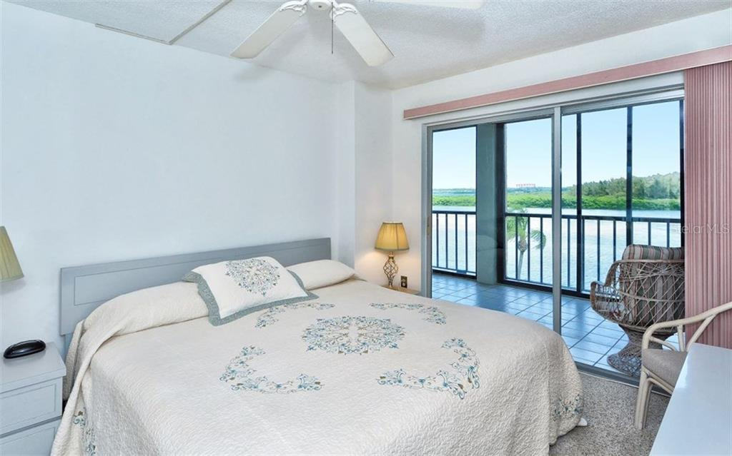 Master bedroom with sliders to balcony with Intracoastal views - Condo for sale at 9397 Midnight Pass Rd #403, Sarasota, FL 34242 - MLS Number is A4185842