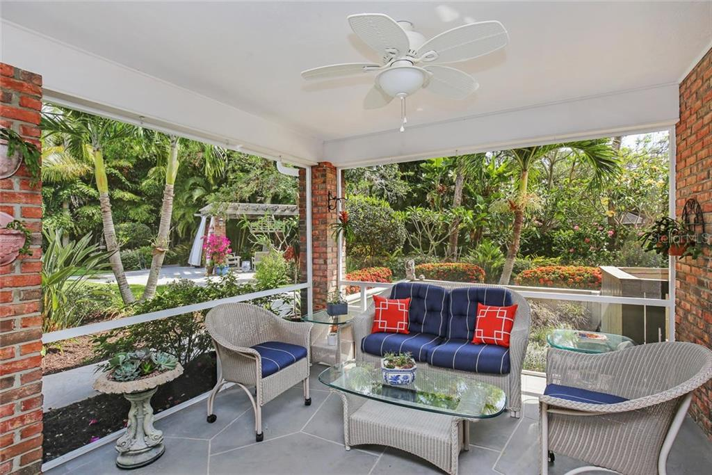 Screened and covered outdoor lanai with fan and peaceful view of the lush butterfly gardens, palms and large pool. - Single Family Home for sale at 3765 Beneva Oaks Blvd, Sarasota, FL 34238 - MLS Number is A4185879