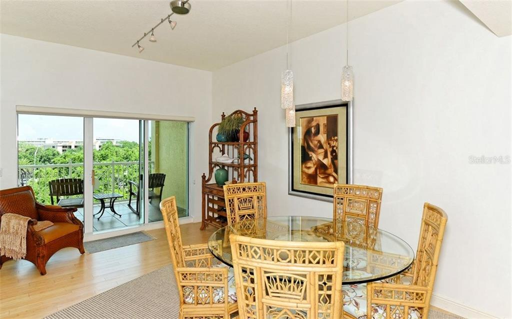 Dining area with sliders to covered terrace - Condo for sale at 1310 Old Stickney Point Rd #e53, Sarasota, FL 34242 - MLS Number is A4186018
