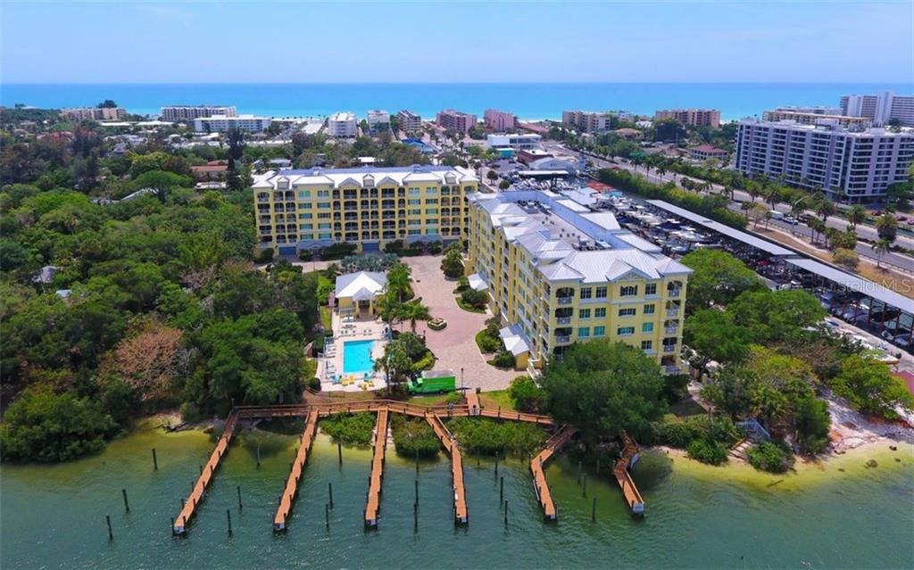 Aerial view of community and Gulf of Mexico - Condo for sale at 1310 Old Stickney Point Rd #e53, Sarasota, FL 34242 - MLS Number is A4186018